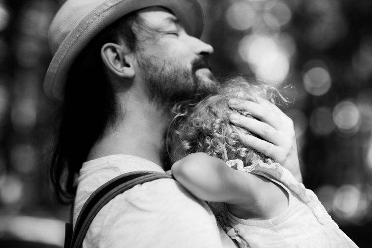 Close-up of father embracing daughter outdoors