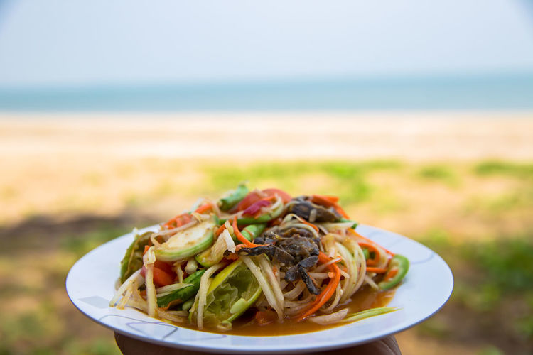 Close-up of food served on beach