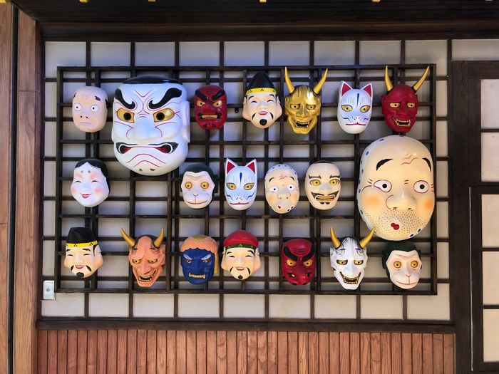 Various Masks For Sale At Market Stall