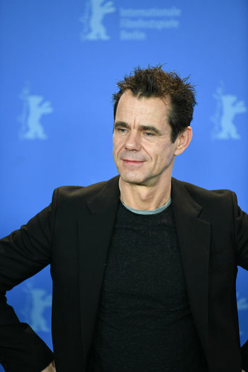 Berlin, Germany - February 15, 2018: German director and Jury President of the 68th edition of the Berlinale international film festival, Tom Tykwer, poses during a photocall Famous Film Festival Jury Photocall Berlinale Berlinale 2018 Celebrities Film Director International Film Festival Looking At Camera One Man Only One Person People Portrait Smiling Waist Up Well-dressed
