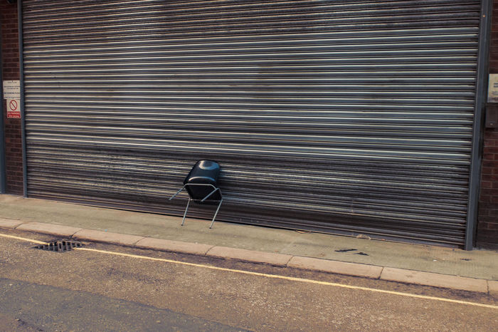 Plastic Chair leaning against Shutters Absence Alone Asphalt Chair Chair Lleaning Against Shuttered Lockup Urban City Back Streets West End London Documentary Nature Photography Photography Taking Photos A Empty Floor Flooring High Angle View Journey Narrow Pavement Reportage Street Photos Taking Fotos Images Photographic Camera Lens Architectural Design Building Structual Support Detail Of Tower Block In Sunshine Blue Sk Seat Shadow Sidewalk Text The Way Forward Transfer Print Wall Western Script Pmg_lon