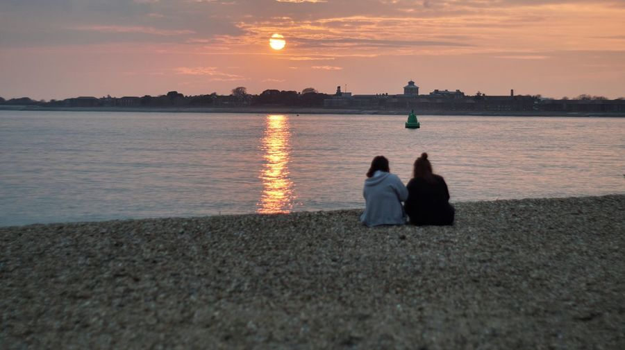 Girls Coastline Clouds Clouds And Sky Water Sunset Sea Togetherness Women Beach Sitting Friendship Relaxation Rear View Romantic Sky Silhouette Atmospheric Mood Calm Shore Outline Overcast Horizon Over Water Tranquil Scene Couple Inner Power