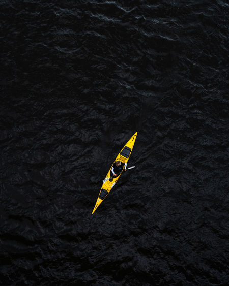 High angle view of yellow floating on sea