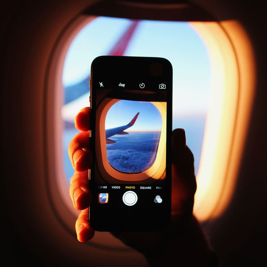 Just go! EyeEmNewHere Smart Phone Photography Themes Device Screen Close-up Indoors  Plane Aeroplane Aircraft Wing IPhone Sunset Iceland Nature Sky Clouds And Sky Hand Airberlin Wing Technology Mobile Phone Sunlight Sun Close Up Technology Mobile Conversations