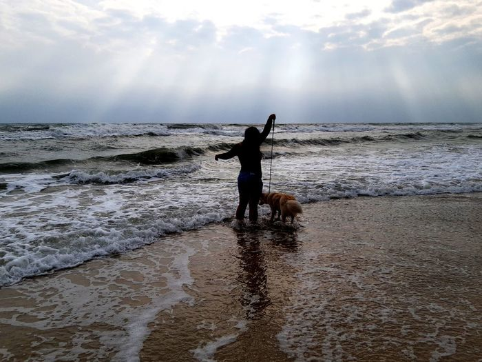 Dog's first time feel the sea New Things  New Things In Life. RRPH Sea Side RRPH First Time Experience First Time At The Beach First Time Beach Water Sea Beach Standing Child Silhouette Sky Horizon Over Water Wave EyeEmNewHere Capture Tomorrow Moments Of Happiness It's About The Journey Redefining Menswear