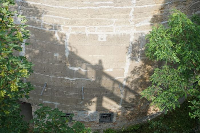 Any photo of a shadow is a double exposure Summer Historical Building Nazi Building Germania Plant Sunlight Day Built Structure Architecture Shadow No People Nature High Angle View Wall - Building Feature Tree Outdoors Building Exterior Wall Green Color Focus On Shadow Old