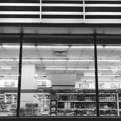 Riding Blackandwhite Night Convenient Store Indoors  Architecture Built Structure No People Illuminated Day City