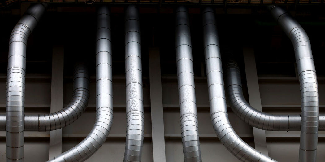 Low angle view of air ducts in factory