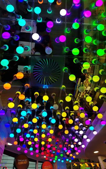 Low angle view of illuminated lights in ceiling