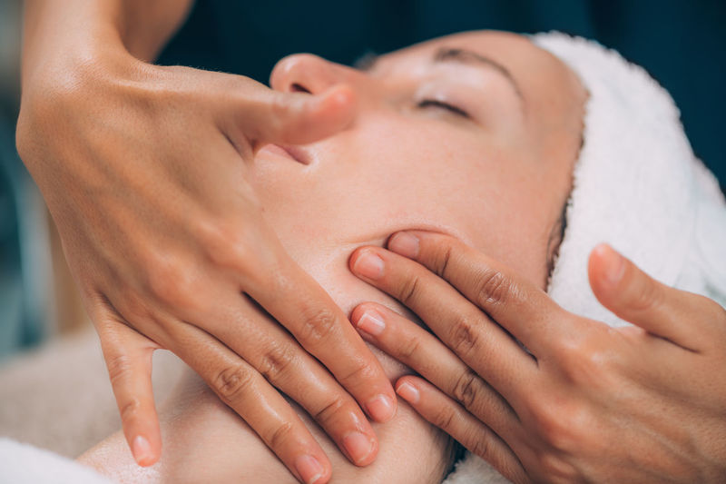 Close-up of woman getting massage therapy at spa