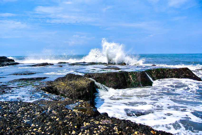 Spindrift Beauty In Nature Blue Cloud Cloud - Sky Day Horizon Over Water Idyllic Motion Nature Non-urban Scene Outdoors Power In Nature Remote Rock - Object Rock Formation Scenics Sea Shore Sky Splashing Stone Tranquil Scene Water Wave