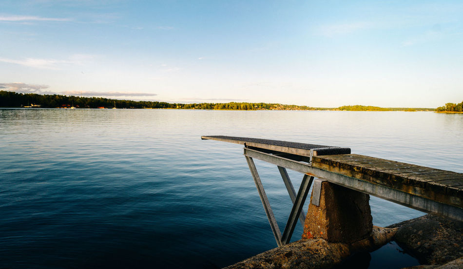 Trampoline in Stockholm Archipelago Archipelago Travel Beauty In Nature Day Diving Platform Lake Nature No People Outdoors Pier Scenics Sky Stockholm Archipelago Trampoline Tranquil Scene Tranquility Travel Destinations Tree Water The Great Outdoors - 2018 EyeEm Awards