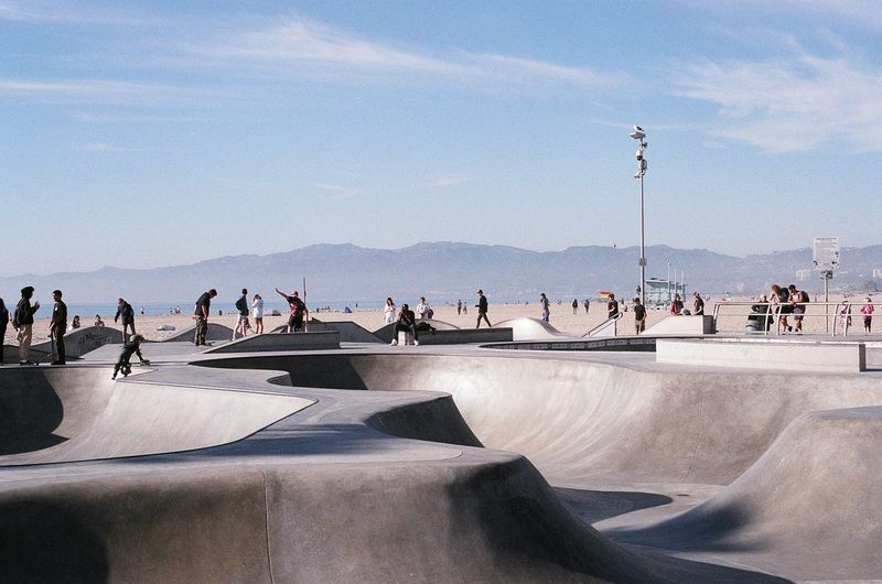 People At Skateboard Park Against Sky