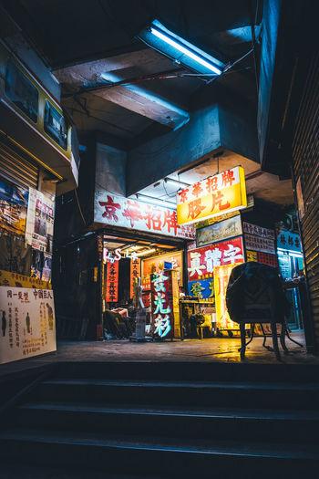 Illuminated street market at night