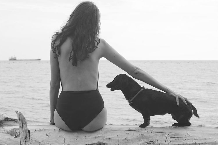 lady and dog Shape Basset Hound Basset Hound Moments Basset Hound Photography Beach Beautiful Woman Blackandwhite Cares Dog Domestic Animals Hair Land Lifestyles Mammal Model One Animal One Person Pets Real People Sausage Sea Swimsuit Swimsuit Fashion Water Women Summer Road Tripping