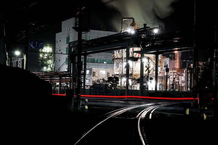 View of railroad tracks at night