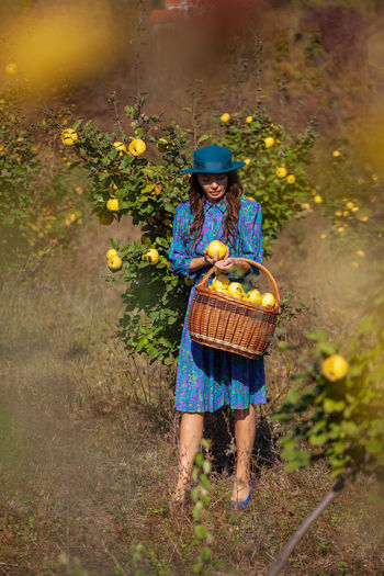 Woman picking fruits from plants