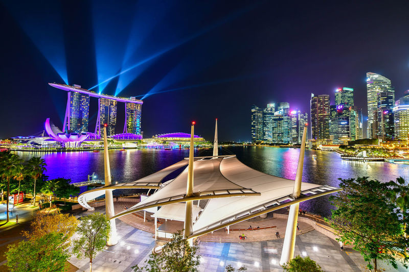 Laser show of Marina bay sands Singapore city skyline this is travel landmark Marina Bay Sands Singapore Architecture Bay Building Building Exterior Built Structure City Cityscape Illuminated Luxury Modern Nature Night No People Office Building Exterior Outdoors Sky Skyscraper Tall - High Tower Travel Destinations Water
