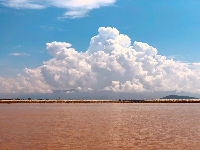 Irawaddy river and bright blue sky on one fine day Sky Cloud - Sky Water Scenics - Nature Land Sea Tranquility Environment Outdoors Landscape Tranquil Scene Day Beach Beauty In Nature Travel Nature No People Blue Sand Salt Flat