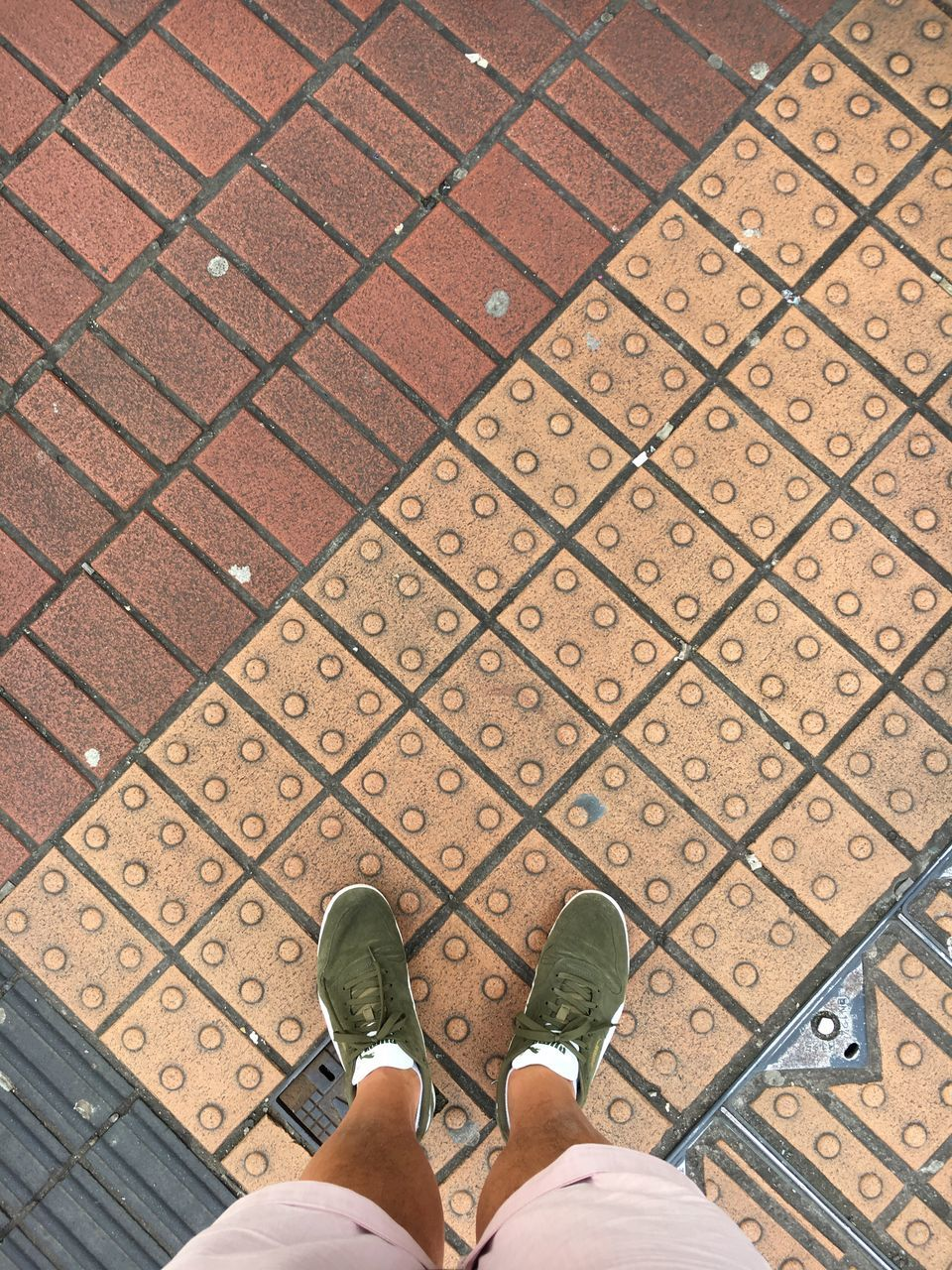 human leg, low section, human body part, shoe, personal perspective, one person, human foot, standing, real people, cobblestone, high angle view, outdoors, day, street, lifestyles, sidewalk, directly above, pattern, men, one man only, adults only, adult, people, close-up, only men