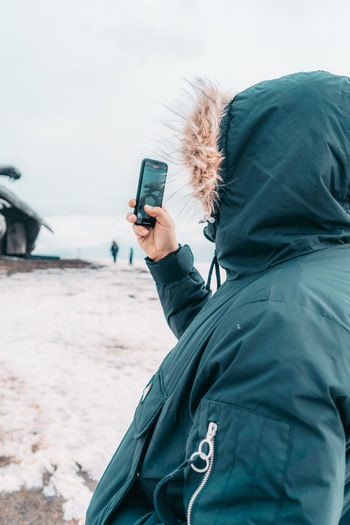 Man photographing with mobile phone