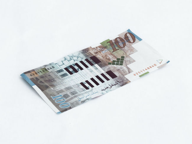 One banknote worth 100 Israeli shekels isolated on a white background Wealth Banknotes Business Currency Economy Foreign Rich Bank Banknote Cash Close-up Commerce Credit Debt Economic Finance Investment Israel Money Paper Pay Profit Saving Shekel White Background