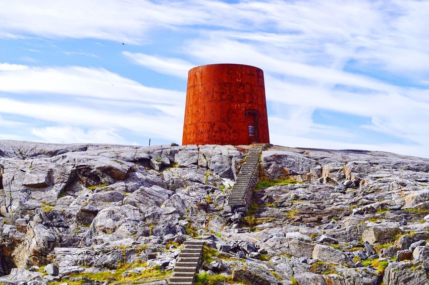 Step up to the Fez (actually the old lighthouse on Runde) Runde Rocks And Clouds Old Lighthouse Rusty Metal Rusty Red Old Building Exterior Steps Sky Cloud - Sky Built Structure Architecture Industry Day Nature Building Exterior Low Angle View Rock