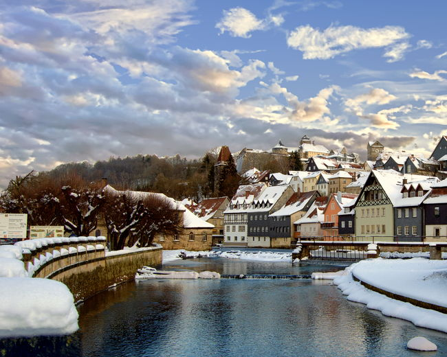 Snow covered houses and river in winter - Kronach, Bavaria, Germany Bavaria Architecture Building Building Exterior Built Structure City Cloud - Sky Cold Temperature Day Germany House Kronach Nature No People Outdoors Residential District River Sky Snow Tree Water Winter