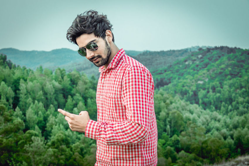 Adult Beard Black Hair Casual Clothing Checked Pattern Day Facial Hair Hairstyle Land Landscape Looking At Camera Men Mustache Nature One Person Plant Portrait Standing Tree Young Adult Young Men The Traveler - 2018 EyeEm Awards The Portraitist - 2018 EyeEm Awards