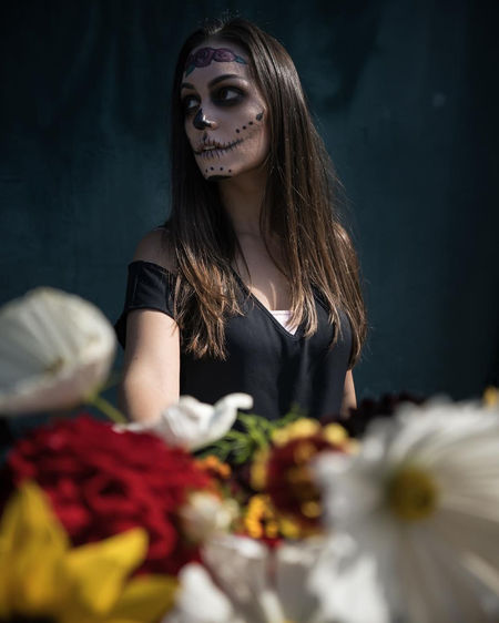 Sugar Skull Skulls Dia De Los Muertos DIA DE MUERTOS Mexico Mexican Skeleton Face Paint Make Up Makeup Portraits Unique Perspectives Girl Calavera  Halloween Autumn Dahlia Sunflower Roses Death Lifestyles Foreground Blue Background Young Women Woman Exploring Fun