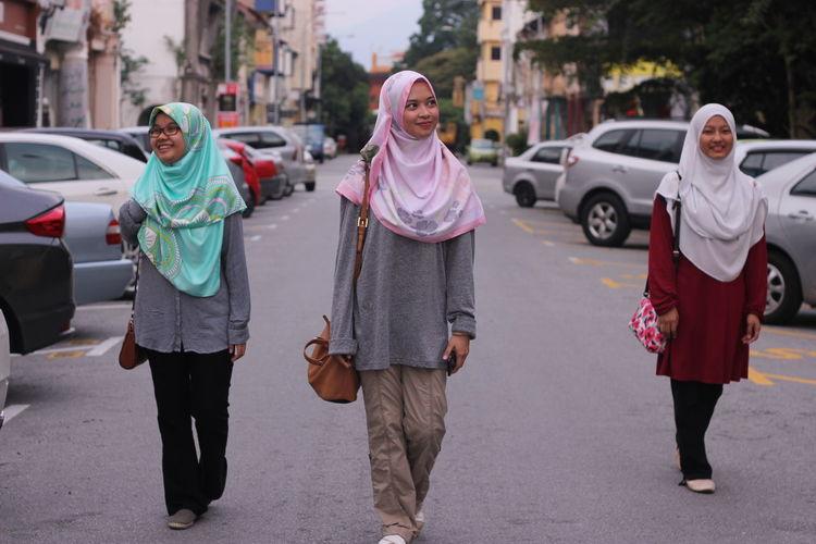 View of people walking on street in city