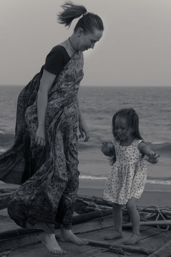 Plays Beach Blackandwhite Casual Clothing Childhood Clear Sky Horizon Over Water Jumping Leisure Activity Outdoors Playing Real People Sea Shore Standing Water Women Who Inspire You