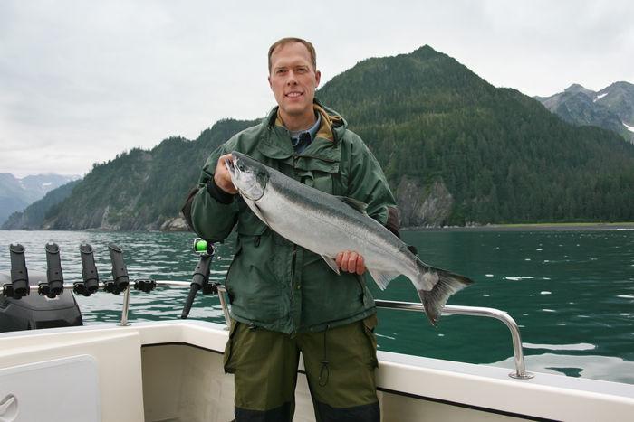 Alaska Boat Fisherman Fishing Leisure Activity Man Ocean Salmon Fishing Saltwater Silver Salmon USA Water Young Adult