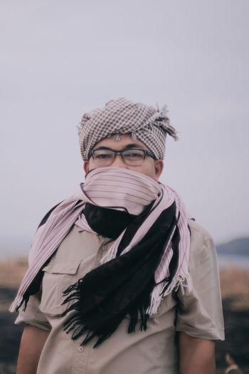 Portrait of man wearing mask against sky