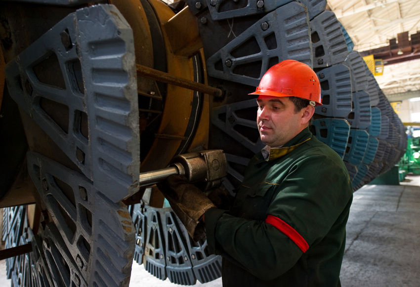 Russia, Stary Oskol, Stoilensky Mining and processing plant, repair of equipment for beneficiation plant Cap Casual Clothing Day Hat Jacket Leisure Activity Lifestyles Metallurgy Mining Industry NLMK Outdoors Portrait Russia россия Stary Oskoll Warm Clothing