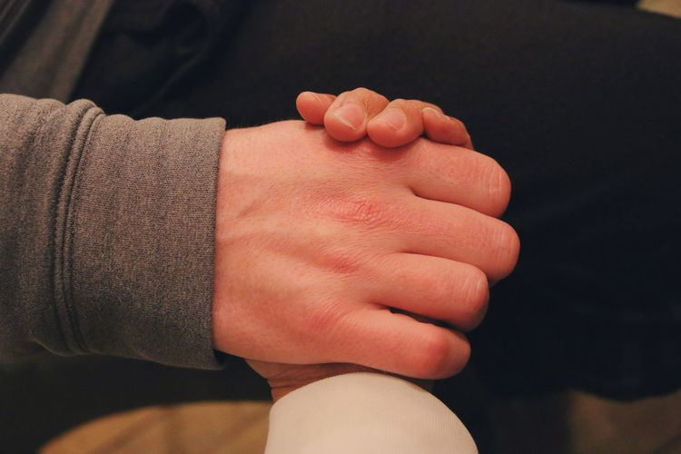 Close-Up Of Cropped Couple Holding Hands