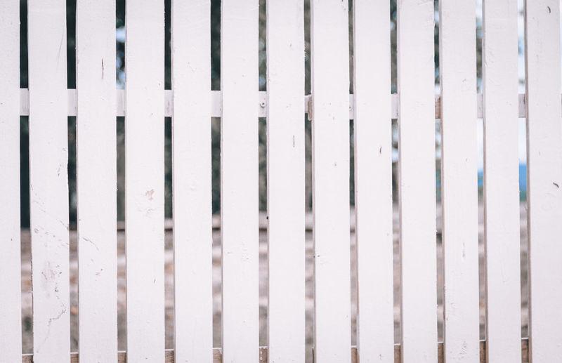 Full frame shot of fence on wall