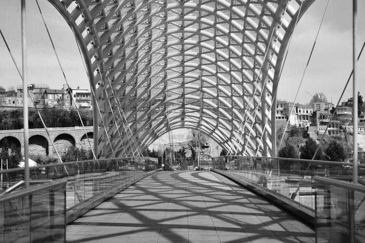 Bridge in city against sky