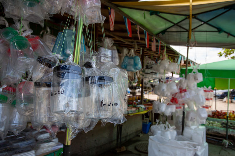 Clothes hanging in market stall