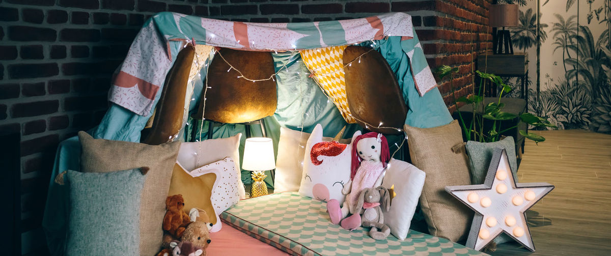 Diy tent decorated and prepared for pajama party