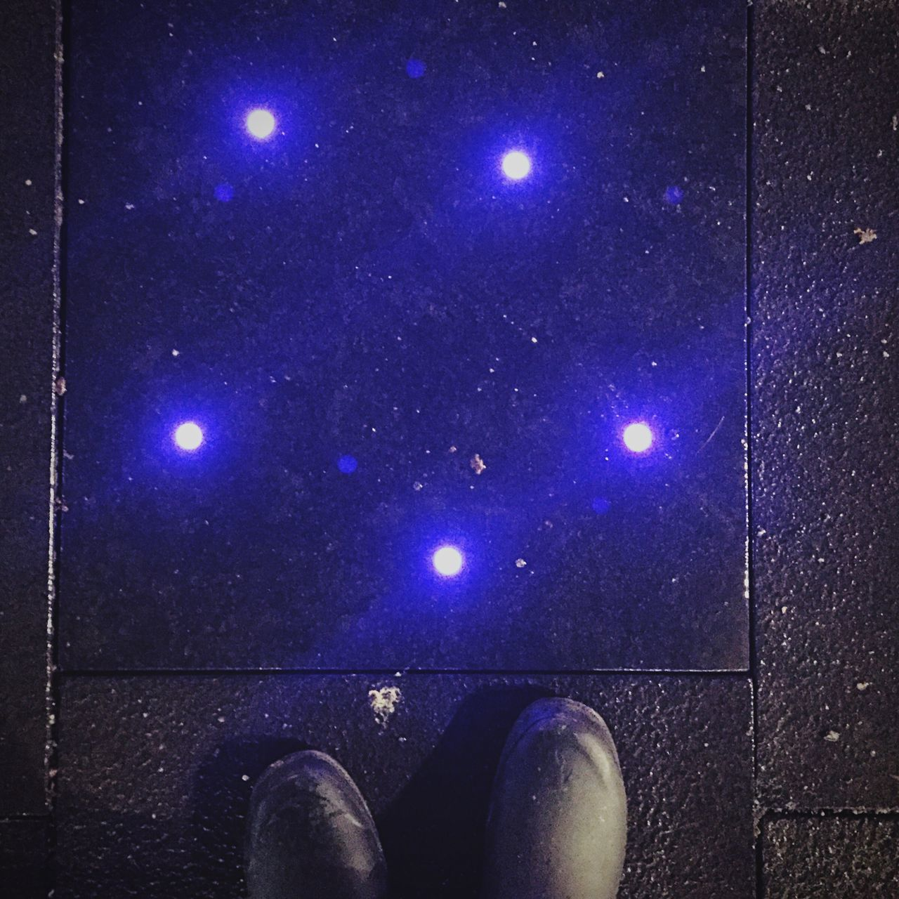 night, low section, illuminated, real people, blue, shoe, human leg, one person, outdoors, human body part, standing, close-up, star - space, astronomy