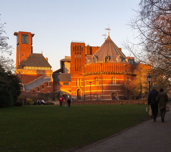 Group Of People Building Building Exterior Architecture Leisure Activity Orange Color Sunset Royal Shakespeare Theatre