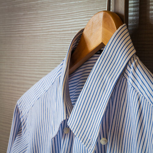 Close-up of shirt on coathanger at home