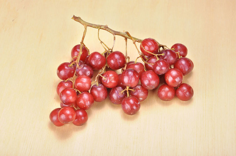 Overhead view  of a bunch of red grapes