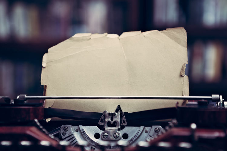 Vintage typewriter with blank sheet of vintage paper in a library Books Library Retro Writer Antique Author Close-up Journalism No People Old Fashioned, Old-fashioned Page Paper Retro Styled Type Typewriter Vintage