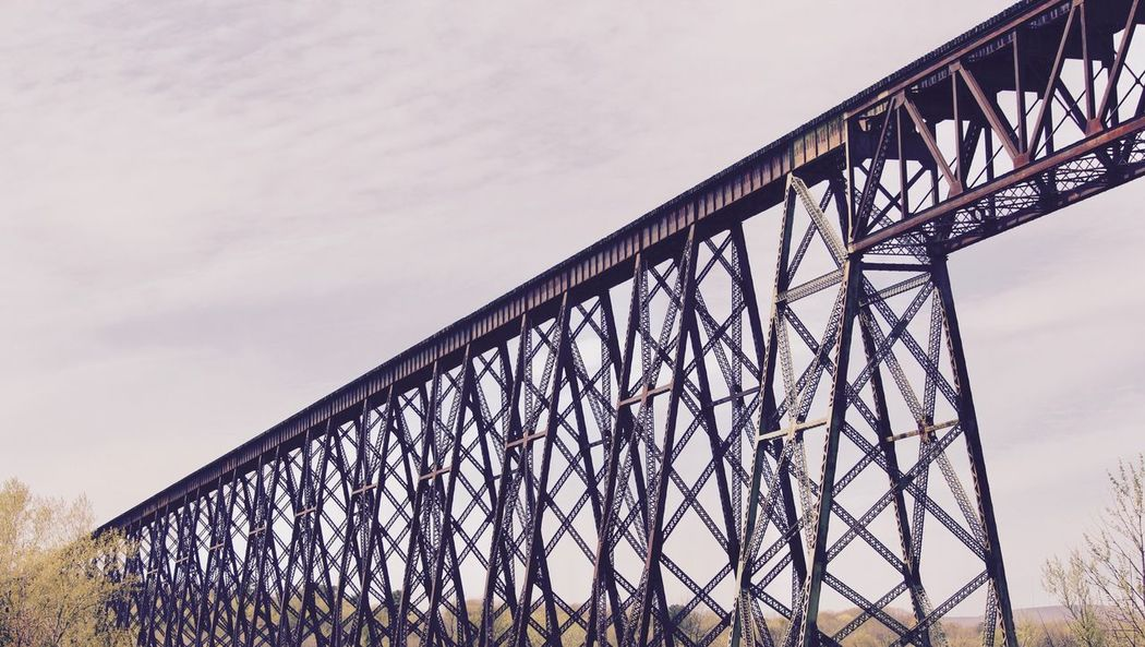 Bridge - Man Made Structure Metal Sky Engineering Connection Built Structure Architecture Low Angle View Railroad Bridge Outdoors Day No People Cloud - Sky Steel Nature quebec Colour Your Horizn