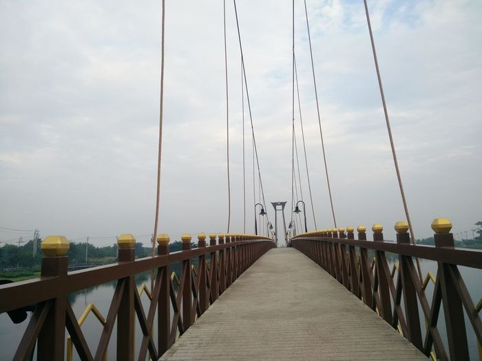 Architecture Bridge Bridge - Man Made Structure Built Structure Connection Day Footbridge Nature No People Outdoors Railing Sea Sky Suspension Bridge The Way Forward Water