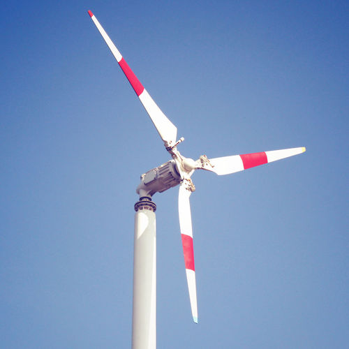 Low Angle View Sky Clear Sky No People Striped Day Nature Blue Copy Space Pole Red Lighting Equipment Environment Turbine White Color Direction Outdoors Wind Turbine Guidance Fuel And Power Generation Architectural Column Windmill