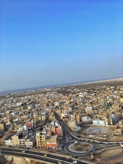 Dakar Building Exterior City Architecture Built Structure Sky Building Cityscape Residential District Clear Sky High Angle View Nature Copy Space TOWNSCAPE Settlement Community Outdoors Water Crowded Sea Blue