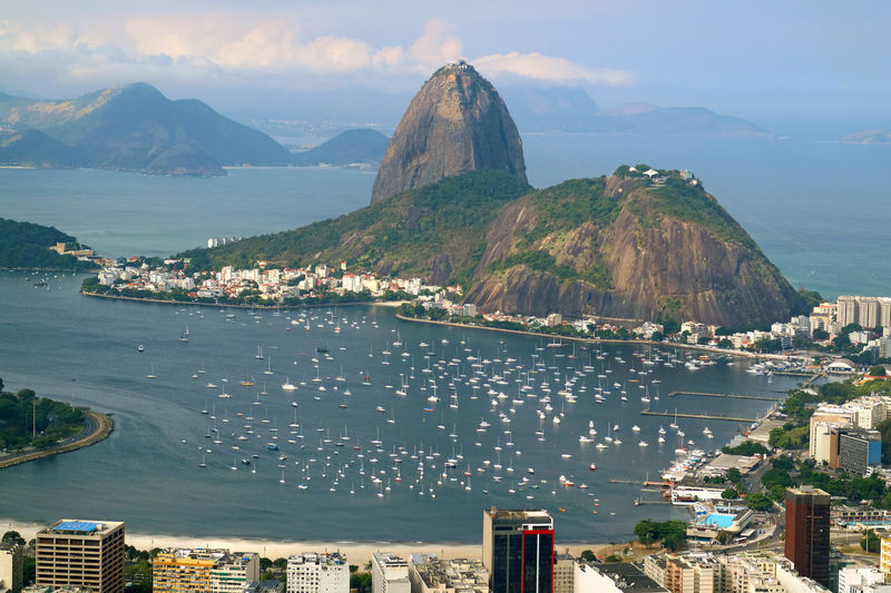 Sugarloaf Mountain or Pao de Acucar, the famous landmark of Rio de Janeiro view from Corcovado Hill in Rio de Janeiro, Brazil Architecture Water City Mountain Sea Sky Building Nature Cityscape Cloud - Sky Residential District High Angle View Transportation Day Travel Destinations Outdoors Bay Rio De Janeiro Copacabana Sugarloaf Sugar Loaf Skyscraper Marina Yacht Botafogo